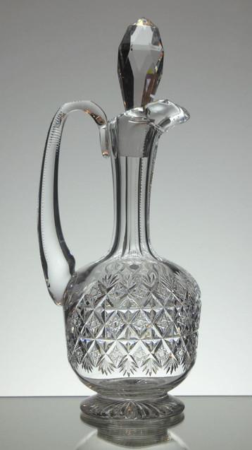 Old Thomass Webb claret jug had cut in wellington pattern size 12 x 5 inches £200.00