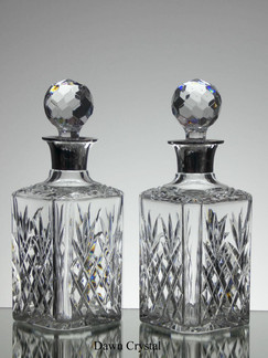 A pair of english hand made full lead crystal whisky decanters hand cut and fitted with silver tops size 10 x 4 x 4 inches £150.00 each