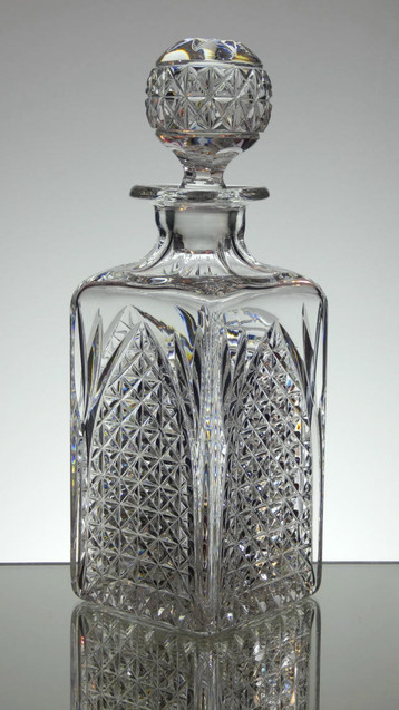 English hand made lead crystal whisky decanter hand cut in church window pattern by Reg Everton size 10.5 x 3.5 x 3.5 inches £95.00