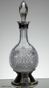 Unique english hand made full lead crystal hogget decanter hand cut in church window pattern by Reg Everton its fitted with a silver top and silver plated base size 14 x 5 inches £350.00
