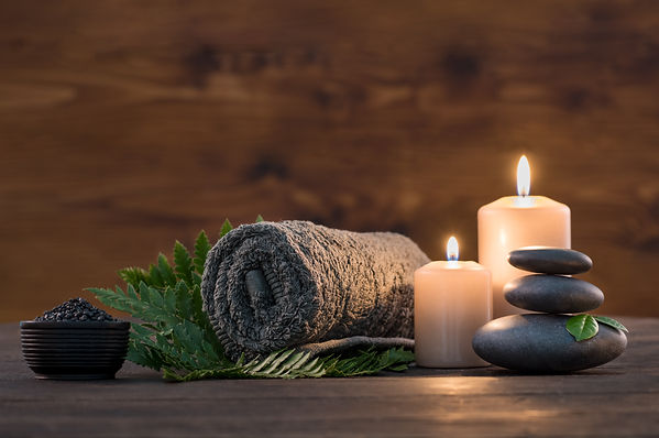 Towel on fern with candles and black hot