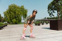 teenage-girl-helmet-learns-ride-roller-s