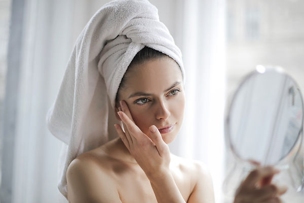 Canva - Tender woman after shower examin