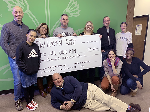 A big check for All Our Kin