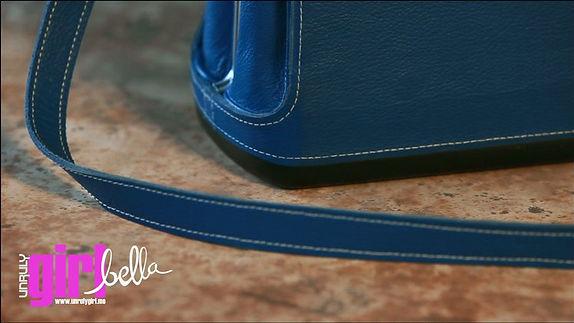 unruly-girl-bella-strap-closeup_png_proj