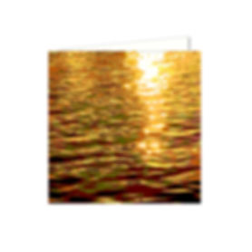 abstract image of water with golden sun, golden water reflections