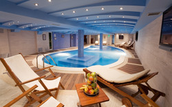 interior-luxury-indoor-pool-house-designs-with-small-pool-with-blue-pillar-in-the-pool-combined-bybl