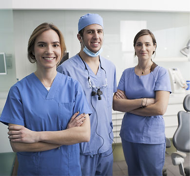 cheerful-group-of-dentists-and-their-ass