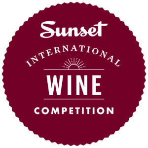 "The Sunset International Wine Competition Logo = Burgundy circle with white text that reads, ""Sunset International Wine Competition"""