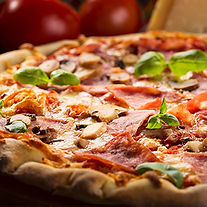 This image shows a fresh baked pizza with mushrooms, pepperoni, basil and tomato sauce.