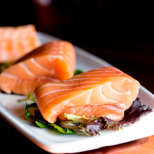Salmon fillets on a plate. Salmon is a good source of Omega 3 fatty acids. Learn more at elevationwellness.co.