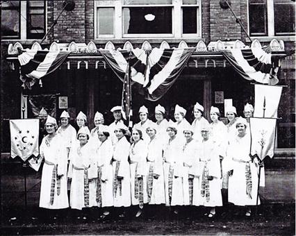 Rebekkah Lodge in front of building, 193