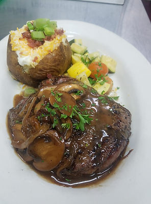 Sirloin with mushrooms and onions with a baked potato