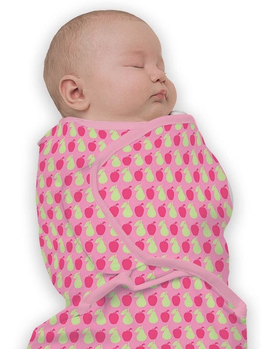 Baby Girl wearing Little Chick London Baby Studio Swaddle in Fruit Pink