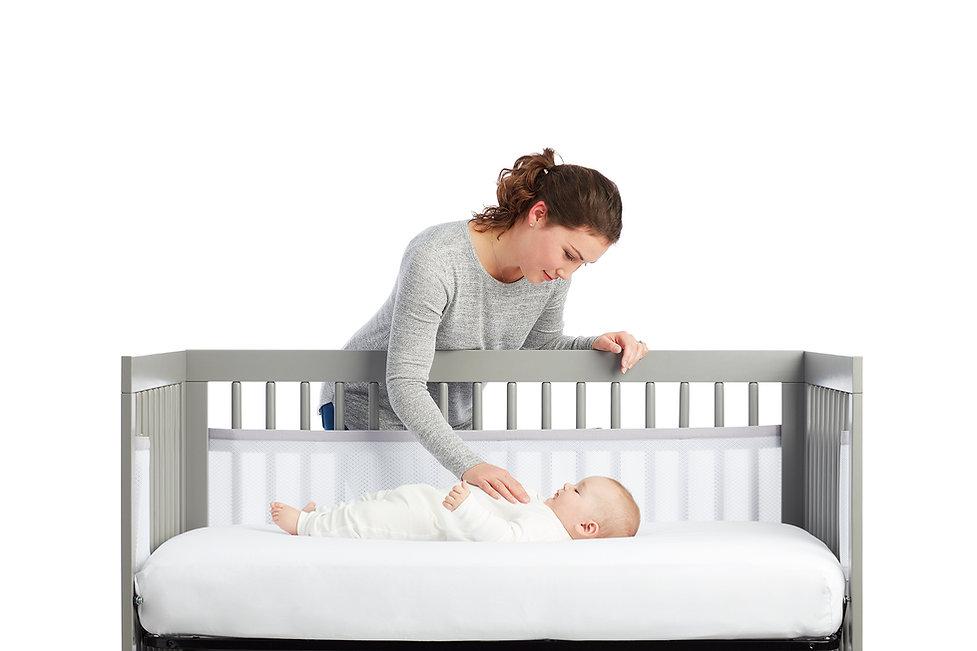 Mum Baby in cot.jpg