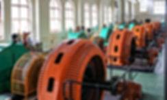 Horizontal axis Pelton wheel turbines turning General Electric alternators. Queenstown Tasmania