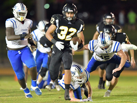 HHS COME OUT ON TOP IN BACK AND FORTH BATTLE
