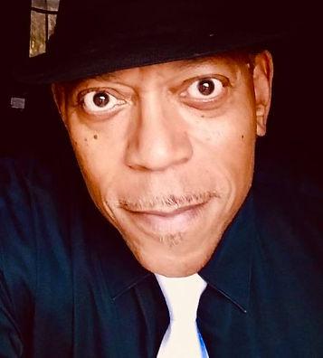Ed black hat balck shirt and tie.jpg