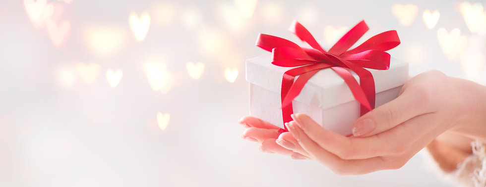 Valentine gift. Beauty Woman hands holdi