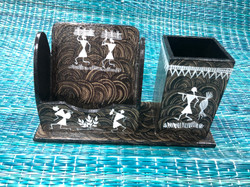 Warli painted mobile pen stand