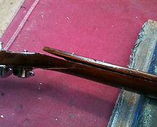 Fingerboard away from neck