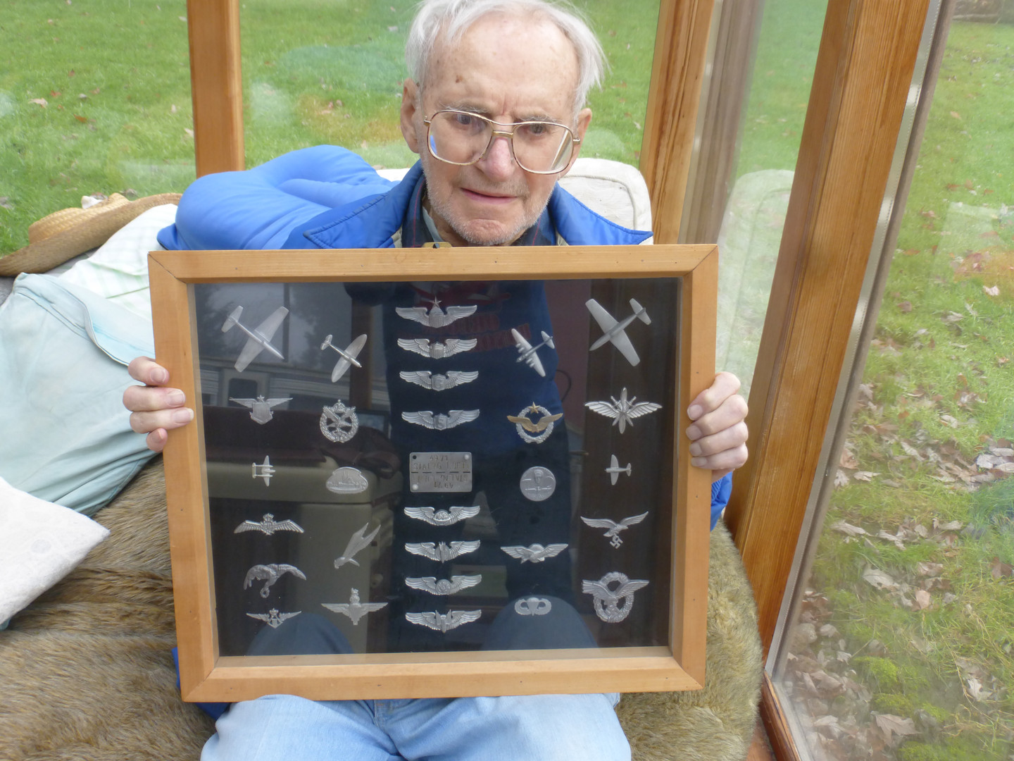 Andy with collection of castings made while in Stalag Luft I.