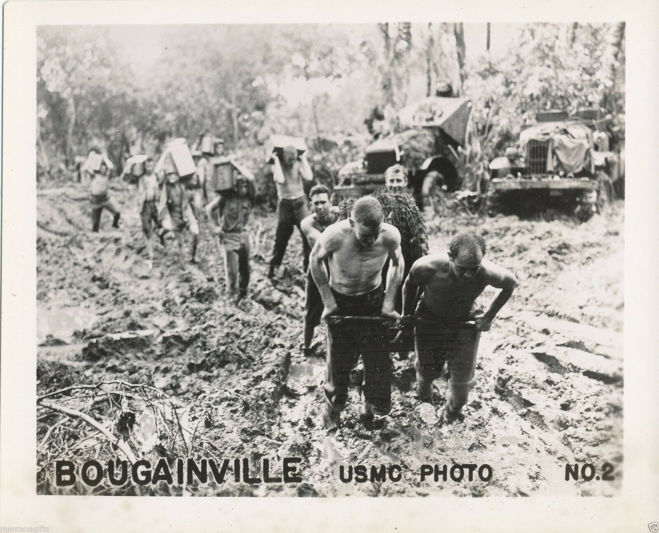 Soldiers slog through Bougainville mud.