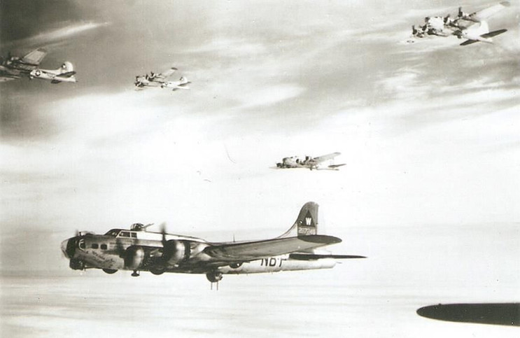 B-17s from the 398 Bomb Group flying in formation.