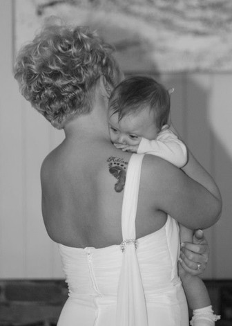 Bride with baby at wedding in conway, SC