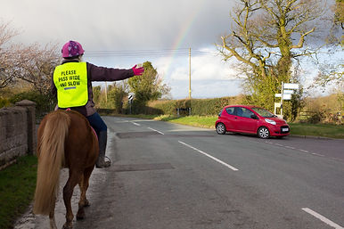 Riding road safety as young girl on pony