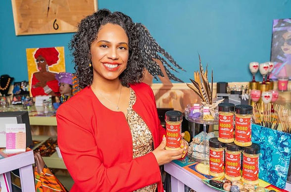 Creator of Spanglish Adobo All Purpose Seasoning poses in I Saw Visions Arts & Culture Boutique