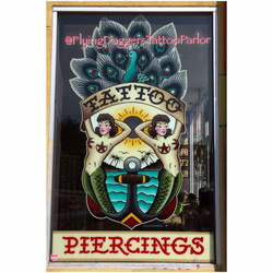 Flying Daggers Tattoo Parlor