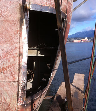 Repairing a hole in the bow hull plate, port of Vancouver, BC