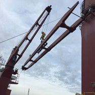 Installing crane jib after repairs completed