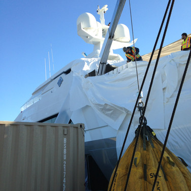Certifying yacht accomodation crane using water bags for test weight.