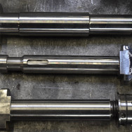 Twist lock pins for container handling machines