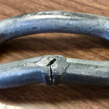 Chain link failed cold bend test at significantly less than the 90˚ requirement