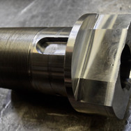 We manufacture twist lock pins and guide blocks in our C&C machine shop