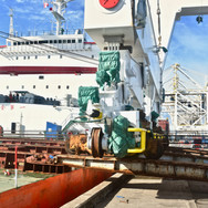 End view of discharge as the crane clears the ship's rail
