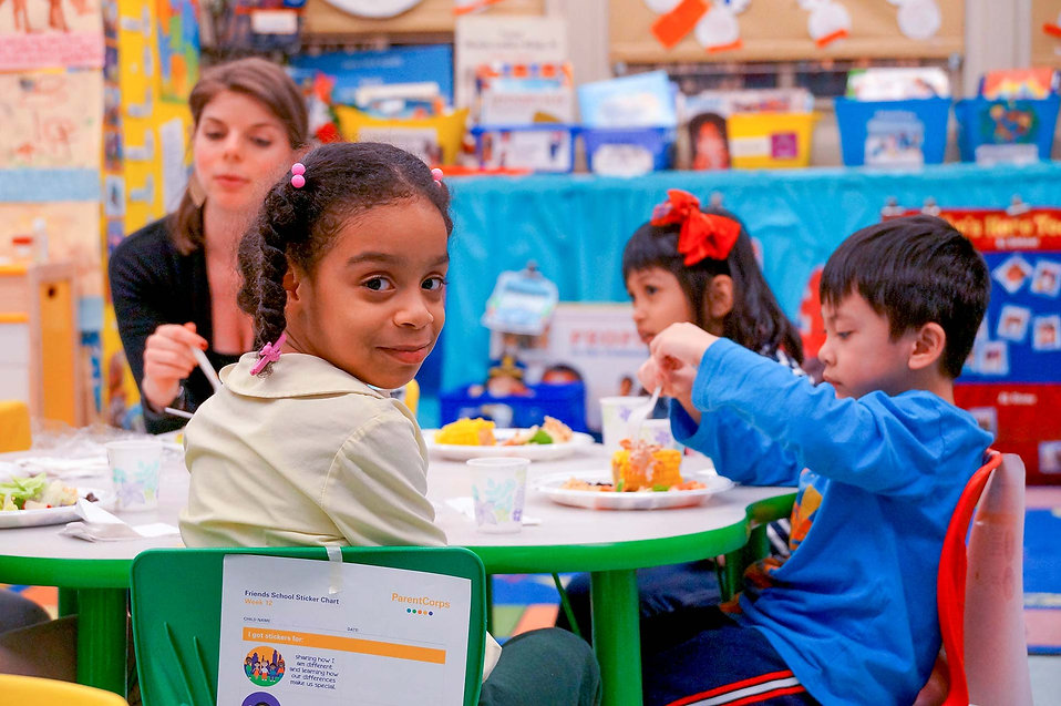 A ParentCorps pre-k student enjoys snack time