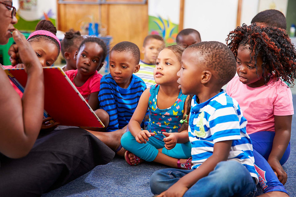 Pre-K children enjoy story time with their teacher