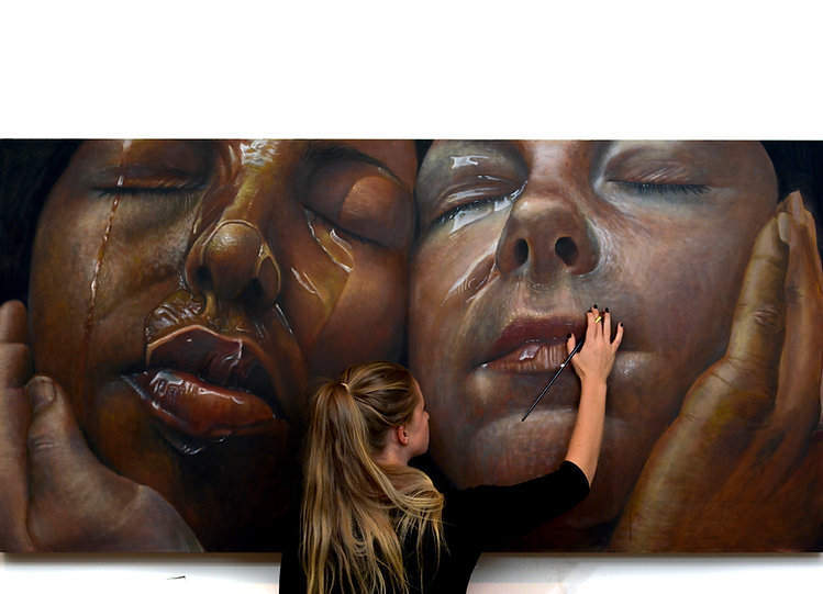 Erica Elan Ciganek painting a large scale portrait of two women.