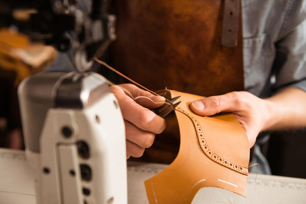 man-artisan-sewing-leather-shoes