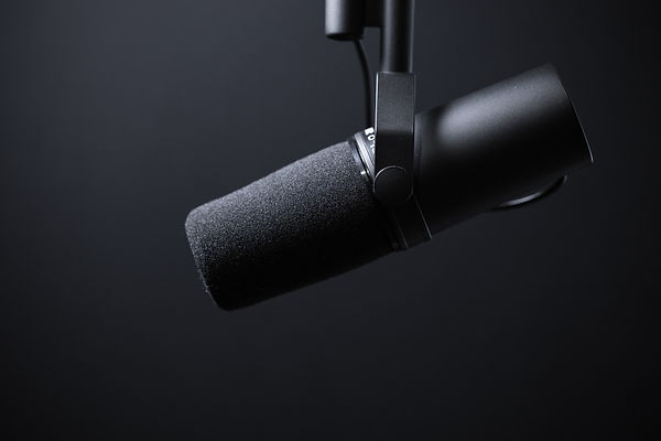 Dynamic podcasting microphone on black.