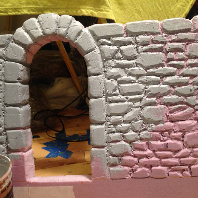 "I carved a piece of insulation foam to create a stone wall for the walled garden set in ""The Doctor in the Garden."""