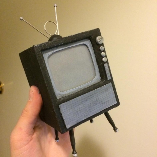 "I made this retro TV for the 1960s-themed video ""The Foregone Storm."" It's made from bass and balsa wood."