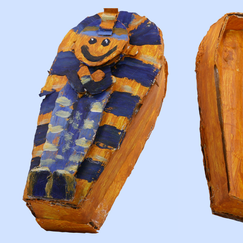 "I made this cardboard sarcophagus and tissue paper mummy for an episode of ""Wonder Pets!""   I Photoshopped the elements so the lid could open, revealing the mummy."