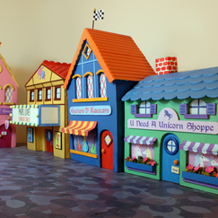 I built this miniature town set for a children's band called Princess Katie and Racer Steve.   It's made from bass wood, paper, and foamcore.