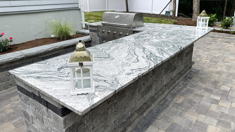 Outdoor stone barbecue and patio pavers