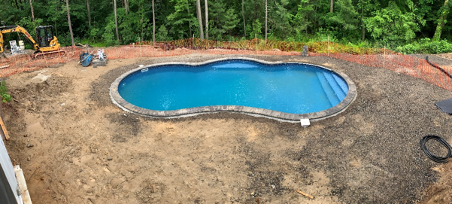 in-ground pool construction in a residential backyard